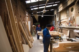 Carpentry workers in the Gudwara's workshop maintain the building