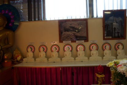In the Ladywood Pagoda a row of Buddhas sits below a selection of pictures showing countries where Buddhists comprise a substantial proportion of the population.