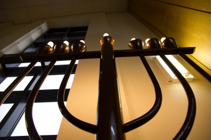 """An electric Menorah (the name translates simply as """"lamp""""). It is a religious candle holder used during the festival of Hanukkah when a new candle is lit every day throughout the holiday."""