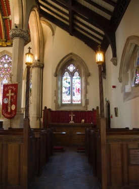 Side chapel altar, with traditional pews facing it at St. John's Church, Ladywood.
