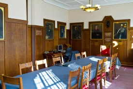 The Council Chamber in Singer Hill Synagogue, central Birmingham. It is here that community elders makes decisions about how the synagogue is run. In doing so they are watched over by portraits of their forbears.