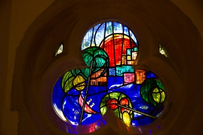 A contemporary stained glass window at St. John's Church, Ladywood. It presents a stylised vision of the Holy Land