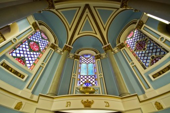 Stained glass windows above the sanctuary in the Singers Hill Synagogue, Birmingham. The central window illustrates the 10 Commandments.