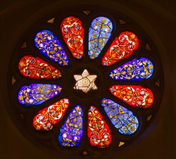 Decorative rose shaped stained glass window in the Singers Hill Synagogue, Birmingham.