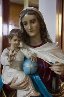 A traditional statue of a Mary Mother of Jesus, holding Jesus whilst he was a young boy. It is found in St. Catherine of Sienna Roman Catholic church, central Birmingham.