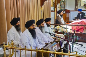 Music plays an important part in Sikh worship. These men have gathered to play during the ceremony.