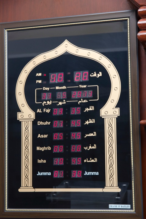 A clock indicating time across the islamic world in Green Lane Mosque, Birmingham