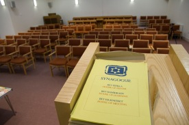 A view from the sanctuary and the lectern across a reformed synagogue's seating area.