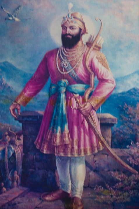 The figure of the warrior is very important in Sikhism. This is because of their historic status in India as an (at times) embattled minority. This one is painted on the Gudwara wall.