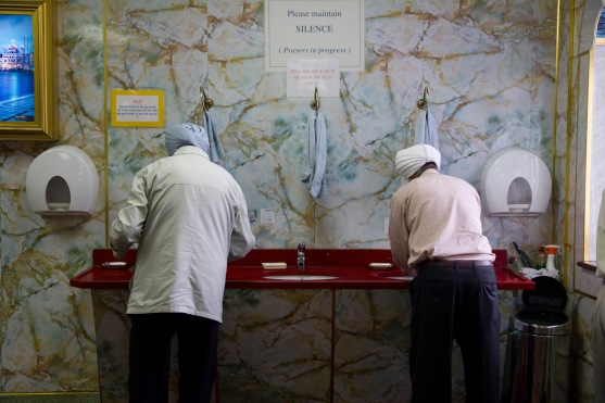 Male worshipers wash before prayers at the Gudwara.