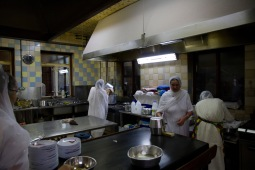 Kitchen workers preparing the food given by the Gudwara community to worshipers and visitors alike.