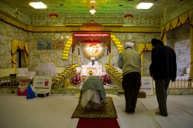 Worshipers in prayer before the altar in the Gudwara.