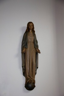 A traditional statue of a young Mary Mother of Jesus. It is found in St. Catherine of Sienna Roman Catholic church, central Birmingham.